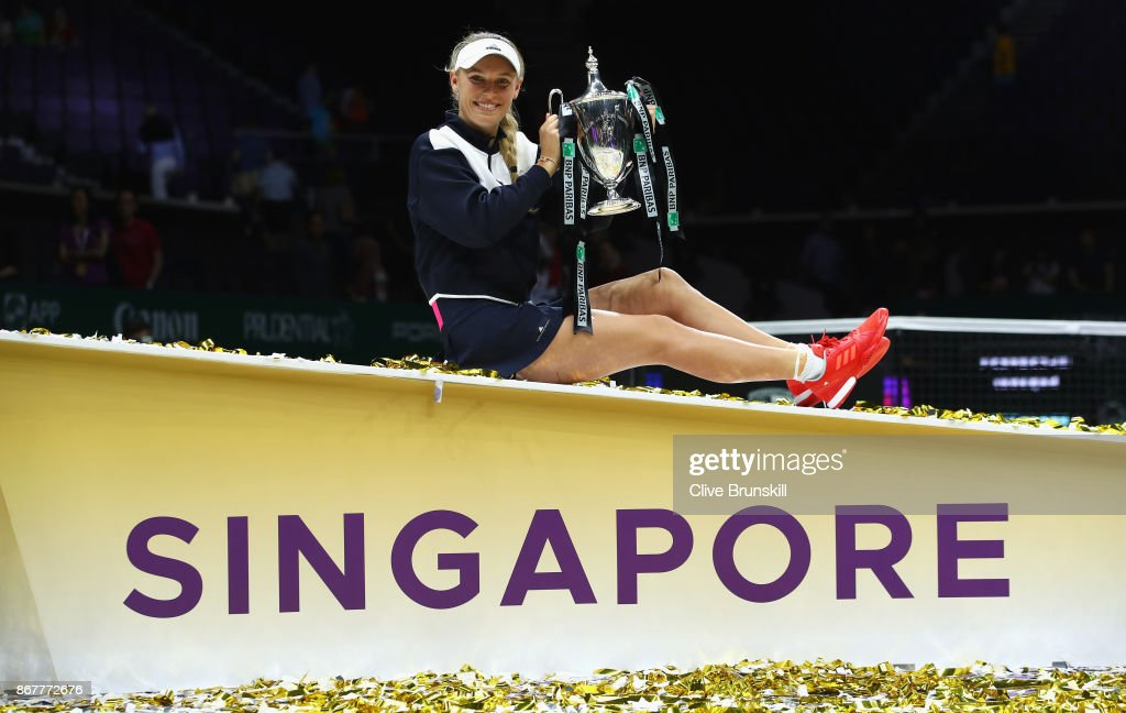 Caroline Wozniacki of Denmark celebrates victory with the Billie Jean King trophy in the Singles Final against Venus Williams of the United States during day 8 of the BNP Paribas WTA Finals Singapore presented by SC Global at Singapore Sports Hub on October 29, 2017 in Singapore.