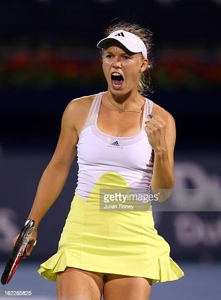 Caroline Wozniacki of Denmark celebrates winning a game against Marion Bartoli of France during day four of the WTA Dubai Duty Free Tennis...