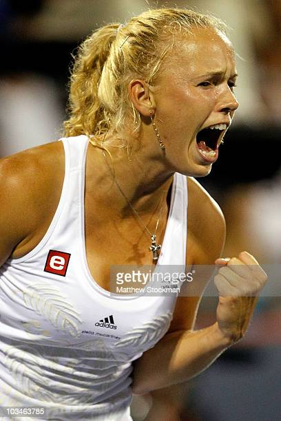 Caroline Wozniacki of Denmark celebrates winning a long rally against Flavia Pennetta of Italy during the Rogers Cup at Stade Uniprix on August 19,...
