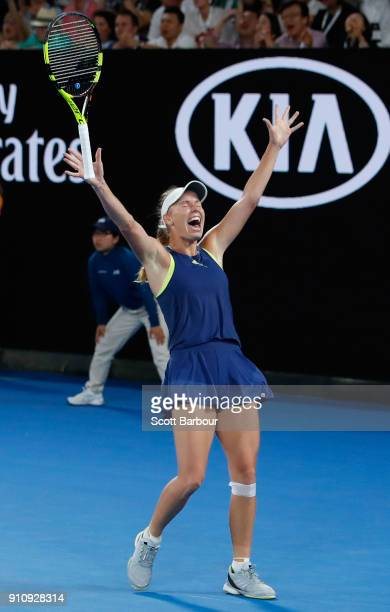 Caroline Wozniacki of Denmark celebrates winning championship point in her women's singles final against Simona Halep of Romania on day 13 of the...