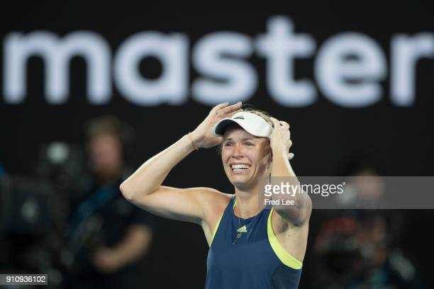 Caroline Wozniacki of Denmark celebrates winning championship point in her women's singles final against Simona Halep of Romaniaon day 13 of the 2018...
