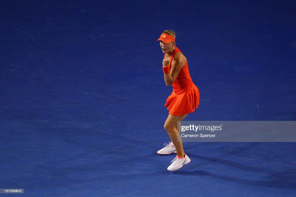 Caroline Wozniacki of Denmark celebrates winning her fourth round match against Jelena Jankovic of Serbia during day seven of the 2012 Australian Open at Melbourne Park on January 22, 2012 in Melbourne, Australia.