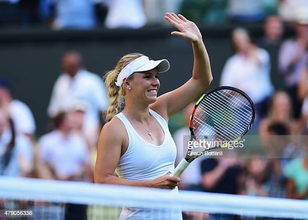 Caroline Wozniacki of Denmark celebrates winning her Ladies Singles first round match against Saisai Zheng of China during day two of the Wimbledon...