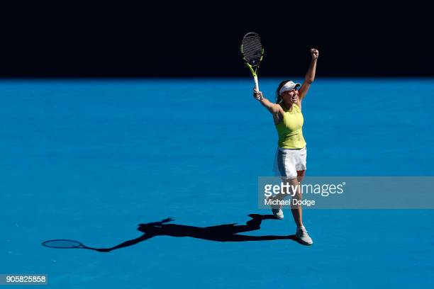 Caroline Wozniacki of Denmark celebrates winning her second round match against Jana Fett of Croatia on day three of the 2018 Australian Open at...