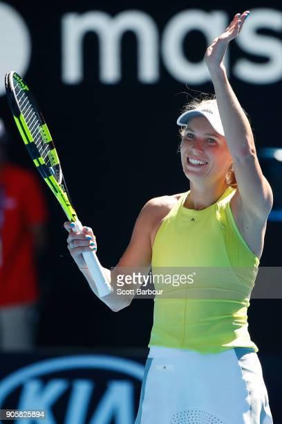 Caroline Wozniacki of Denmark celebrates winning her second round match against Jana Fett of Croatia on day three of the 2018 Australian Open at...