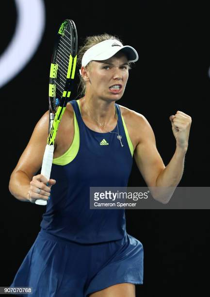 Caroline Wozniacki of Denmark celebrates winning her third round match against Kiki Bertens of the Netherlands on day five of the 2018 Australian...