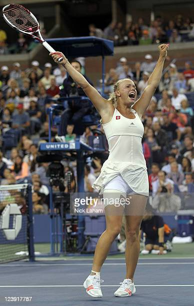 Caroline Wozniacki of Denmark celebrates winning match point against Svetlana Kuznetsova of Russia during Day Eight of the 2011 US Open at the USTA...