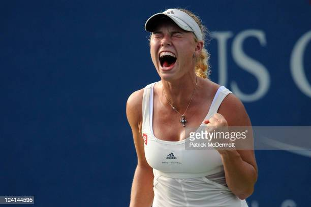 Caroline Wozniacki of Denmark celebrates winning match point against Andrea Petkovic of Germany during Day Eleven of the 2011 US Open at the USTA...