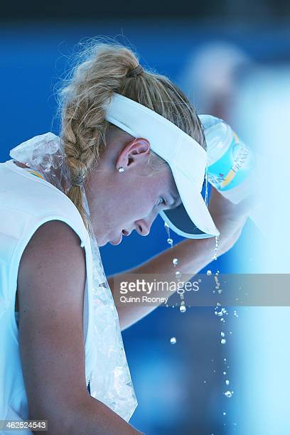 Caroline Wozniacki of Denmark cools off after winning her first round match against Lourdes Dominguez Lino of Spain during day two of the 2014...