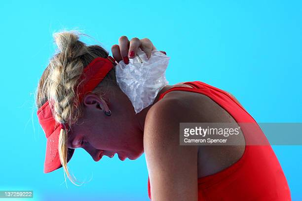Caroline Wozniacki of Denmark cools off in her second round match against Anna Tatishvili of Georgia during day three of the 2012 Australian Open at...
