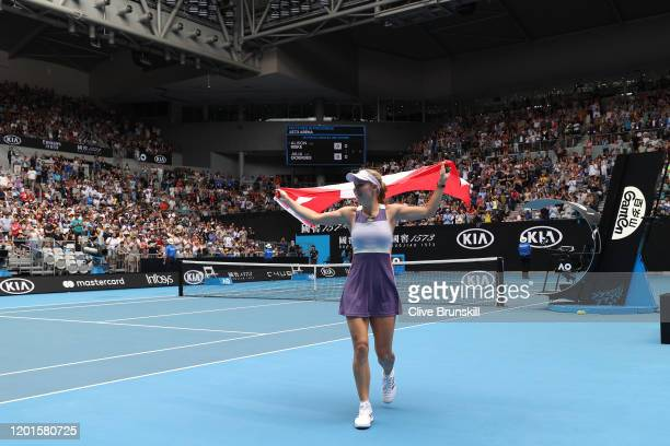 Caroline Wozniacki of Denmark drapes a Danish flag over her shoulders and acknowledges the crowd after losing her Women's Singles third round match...