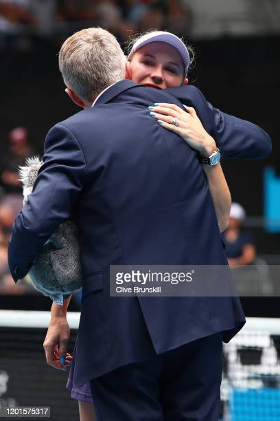 Caroline Wozniacki of Denmark embraces her family after her Women's Singles third round match against Ons Jabeur of Tunisia day five of the 2020...
