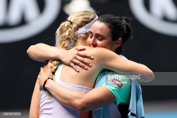 Caroline Wozniacki of Denmark embraces Ons Jabeur of Tunisia after their Women's Singles third round match on day five of the 2020 Australian Open at...