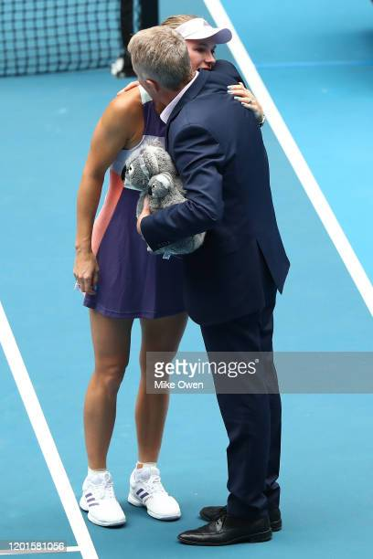 Caroline Wozniacki of Denmark embraces Tournament Director Craig Tilley following her Women's Singles third round match against Ons Jabeur of Tunisia...