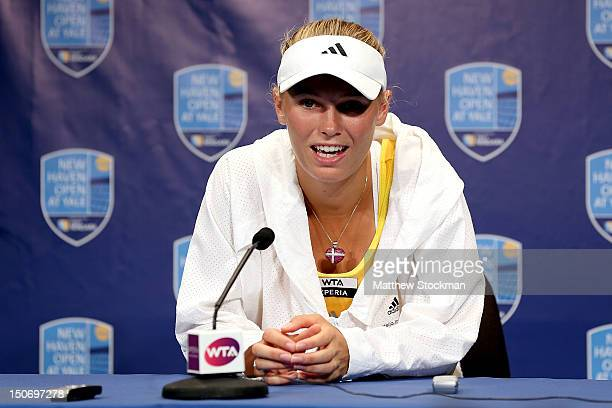 Caroline Wozniacki of Denmark fields questions from the media after retiring from her match against Maria Kirilenko of Russia during the semifinals...