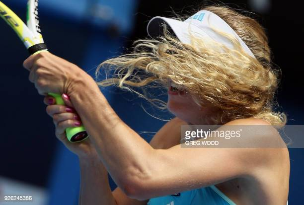 Caroline Wozniacki of Denmark follows through on a return to Ana Ivanovic of Serbia in their women's singles fourth round match at the Australian...