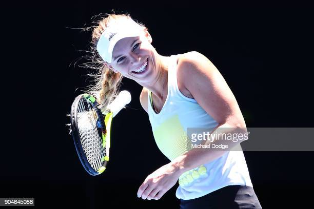 Caroline Wozniacki of Denmark gets her hair tangled in the racquet during a practice session ahead of the 2018 Australian Open at Melbourne Park on...