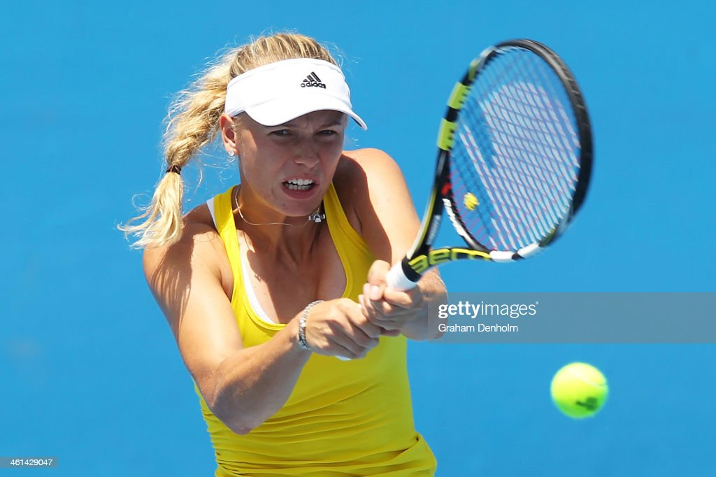 Caroline Wozniacki of Denmark hits a backhand during a practice session ahead of the 2014 Australian Open at Melbourne Park on January 9, 2014 in Melbourne, Australia.