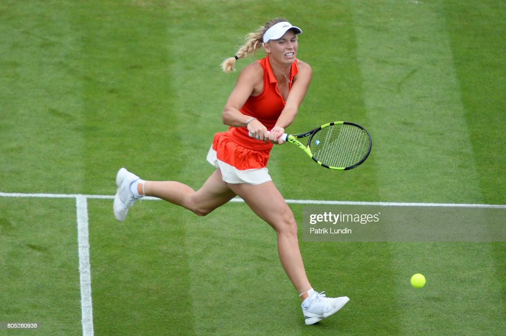 Caroline Wozniacki of Denmark hits a backhand during the Final match against Karolina Pliskova of Czech Republic on day seven of the Aegon International Eastbourne on July 1, 2017 in Eastbourne, England.