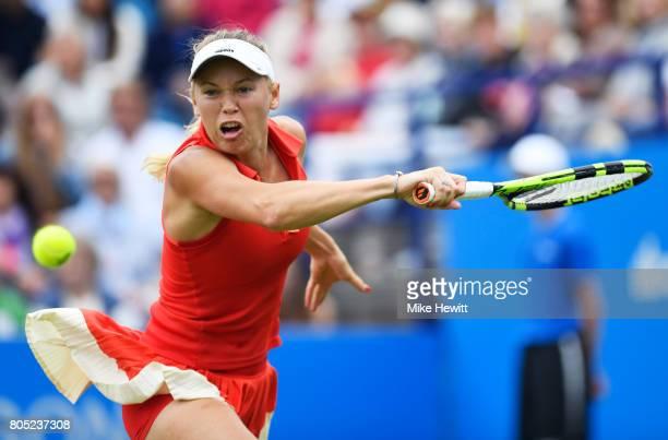 Caroline Wozniacki of Denmark hits a backhand during the ladies singles final against Karolina Pliskova of the Czech Republic on day seven of the...