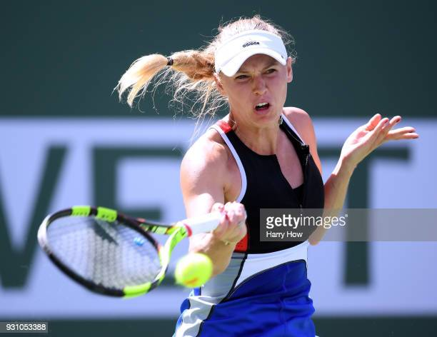 Caroline Wozniacki of Denmark hits a forehand in her match against Aliaksandra Sasnovich of Belarus during the BNP Paribas Open at the Indian Wells...