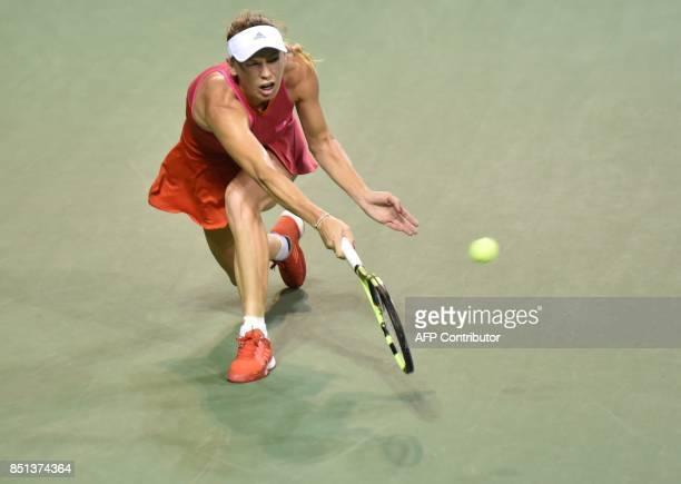 Caroline Wozniacki of Denmark hits a return against Dominika Cibulkova of Slovakia during their women's singles quarterfinal match at the Pan Pacific...