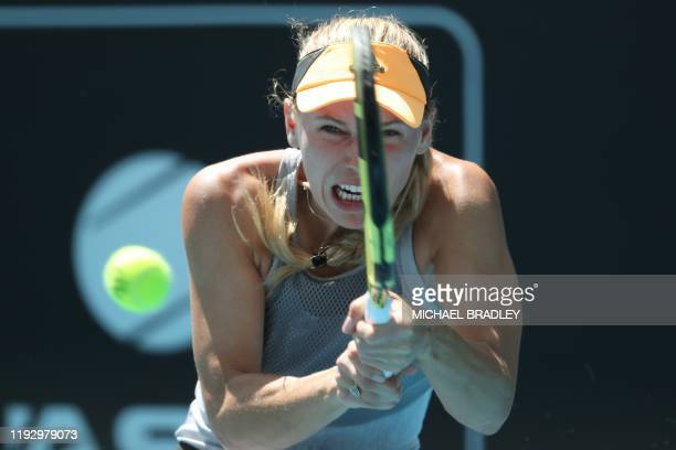 TOPSHOT Caroline Wozniacki of Denmark hits a return against Jessica Pegula of the US during their women's singles semifinal match during the Auckland...