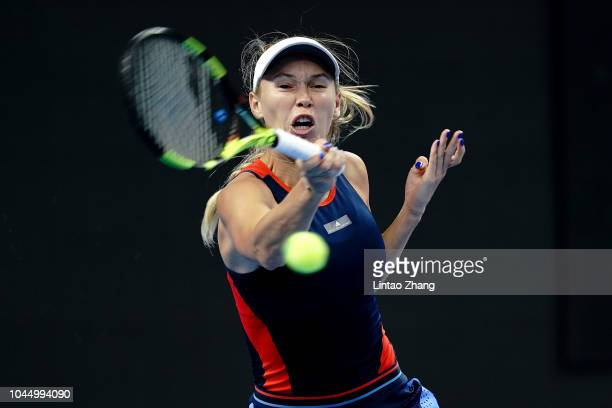 Caroline Wozniacki of Denmark hits a return during her women's singles second round match against Petra Martic of Croatia in the 2018 China Open at...