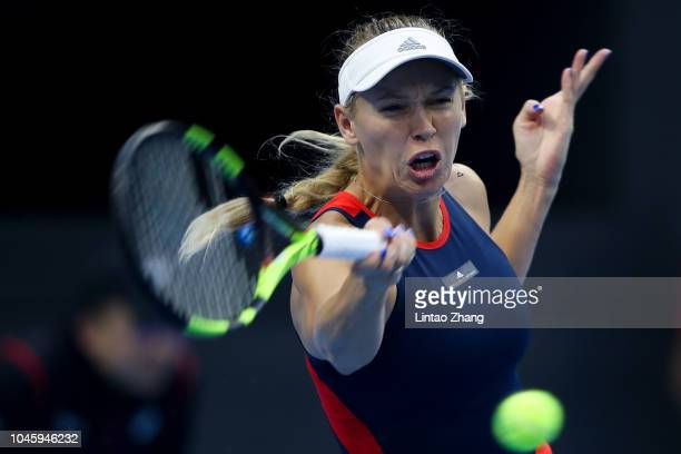 Caroline Wozniacki of Denmark hits a return during her Women's Singles quarterfinals match against Katerina Siniakova of the Czech Republic in the...