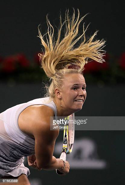 Caroline Wozniacki of Denmark hits a serve to Agnieszka Radwanska of Poland during the BNP Paribas Open at the Indian Wells Tennis Garden on March 19...