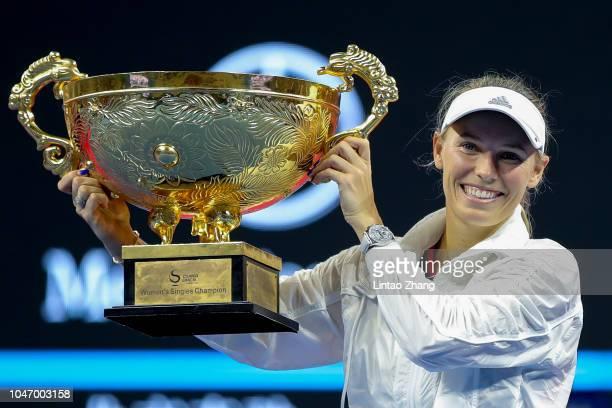 Caroline Wozniacki of Denmark hold the winners trophy after winning the Women's Singles final against Anastasija Sevastova of Latvia on day 9 of the...