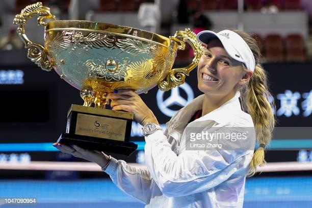 Caroline Wozniacki of Denmark hold the winner's trophy after winning the Women's Singles final against Anastasija Sevastova of Latvia on day 9 of the...