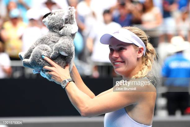 Caroline Wozniacki of Denmark holds aloft a cuddly koala after losing her Women's Singles third round match against Ons Jabeur of Tunisia on day five...