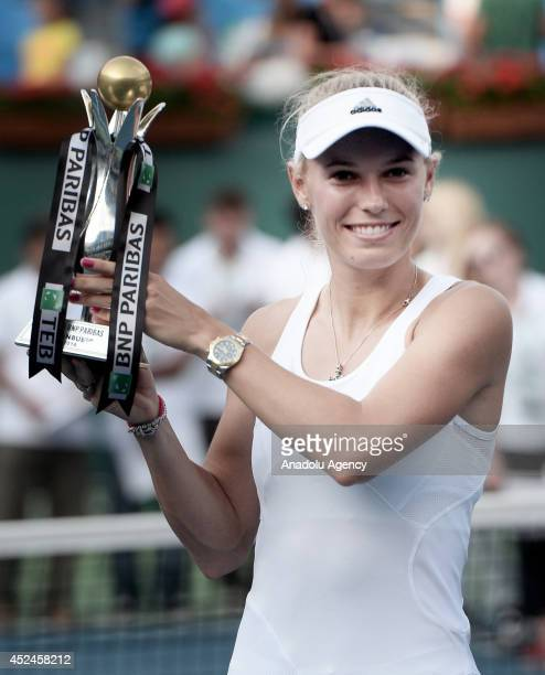 Caroline Wozniacki of Denmark holds her trophy after she won tennis final match against Roberta Vinci of Italy during the TEB BNP Paribas Istanbul...