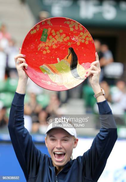 Caroline Wozniacki of Denmark holds the plate during the final of the Toray Pan Pacific Open tennis championships in Tokyo on September 25 2016...