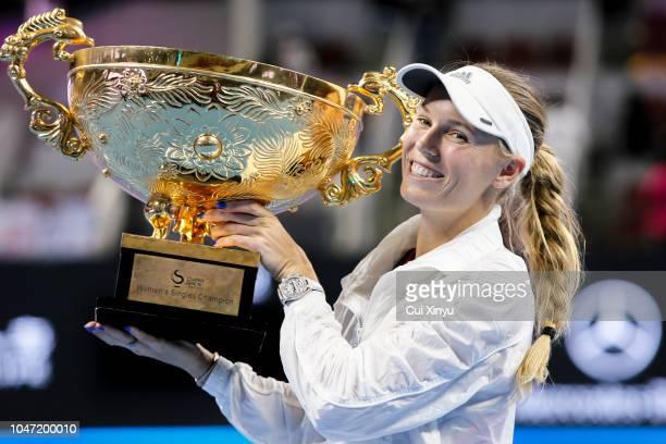 Caroline Wozniacki of Denmark holds the winner's trophy after winning the Women's Singles final against Anastasija Sevastova of Latvia on day 9 of...
