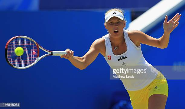 Caroline Wozniacki of Denmark in action against Christina McHale of the United States of America during day four of the AEGON International on June...