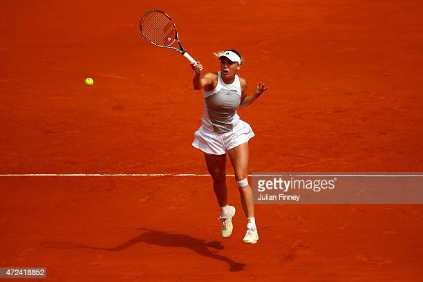 Caroline Wozniacki of Denmark in action against Maria Sharapova of Russia in the quarter finals during day six of the Mutua Madrid Open tennis...