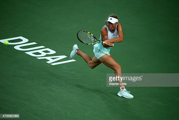 Caroline Wozniacki of Denmark in action against Sabine Lisicki of Germany during day two of the WTA Dubai Duty Free Tennis Championship at the Dubai...