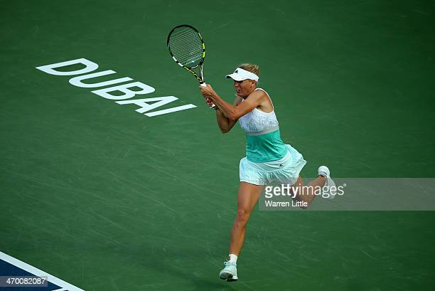 Caroline Wozniacki of Denmark in action against Sabine Lisicki of Germany during day two of the WTA Dubai Duty Free Tennis Championship at the Dubai...