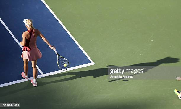 Caroline Wozniacki of Denmark in action against Serena Williams of the US during their US Open 2014 women's singles finals match at the USTA Billie...