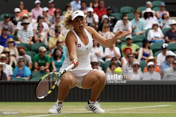 Caroline Wozniacki of Denmark in action during her second round match against KaiChen Chang of Taipei on Day Four of the Wimbledon Lawn Tennis...