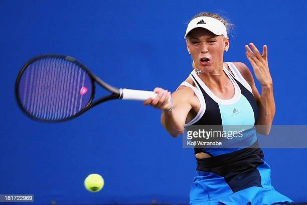 Caroline Wozniacki of Denmark in action during her women's singles second round match against Flavia Pennetta of Italy during day three of the Toray...