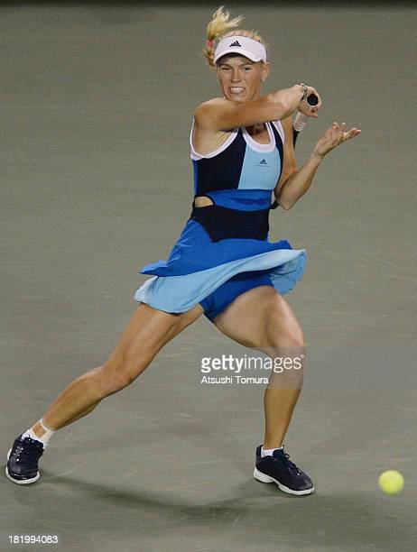 Caroline Wozniacki of Denmark in action during her women's singles semi final match against Angelique Kerber of Germany during day six of the Toray...