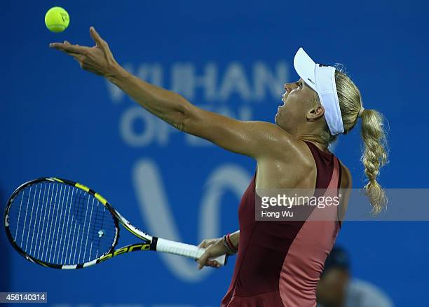Caroline Wozniacki of Denmark in action during the match against Eugenie Bouchard of Canada on day six of 2014 Dongfeng Motor Wuhan Open at Optics...