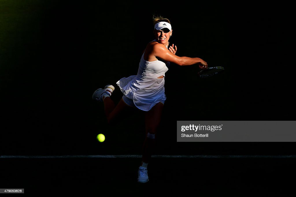 Caroline Wozniacki of Denmark in action in her Ladies Singles first round match against Saisai Zheng of China during day two of the Wimbledon Lawn Tennis Championships at the All England Lawn Tennis and Croquet Club on June 30, 2015 in London, England.