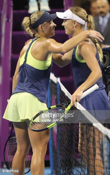 Caroline Wozniacki of Denmark is congratulated by Angelique Kerber of Germany after winning against her in their singles match in the quarterfinal...