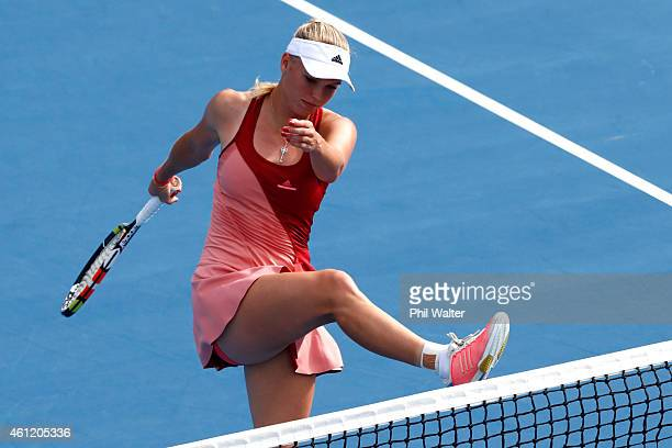 Caroline Wozniacki of Denmark kicks the net during her semifinal match against Barbora Zahlavova Strycova of the Czech Republic during day five of...