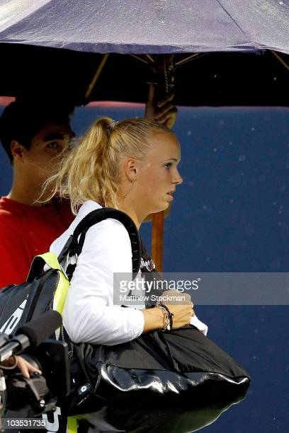 Caroline Wozniacki of Denmark leaves the court as rain suspends her match against Svetlana Kuznetsova of Russia during the semifinals of the Rogers...