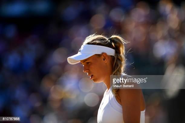 Caroline Wozniacki of Denmark looks on during the Ladies Singles third round match against Anett Kontaveit of Estonia on day six of the Wimbledon...